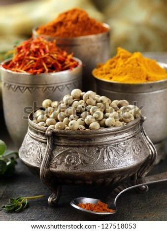 various spices (curcuma, paprika, saffron, coriander) in metal bowls