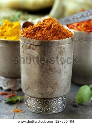 various spices (curcuma, paprika, saffron) in metal bowls