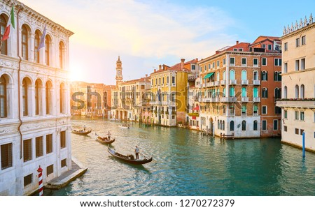 Venetian gondoliers punting gondolas through