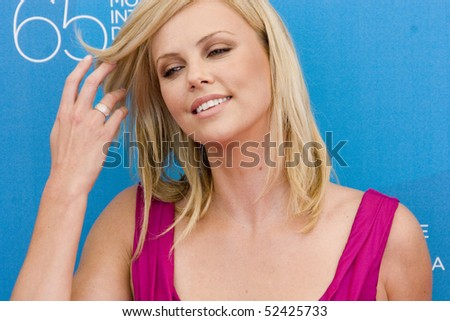 VENICE, ITALY - AUGUST 29: Actress Charlize Theron arrives by boat at the 'The Burning Plain' photocall at the Piazzale del Casino during the 65th Venice Film Festival on August 29, 2008