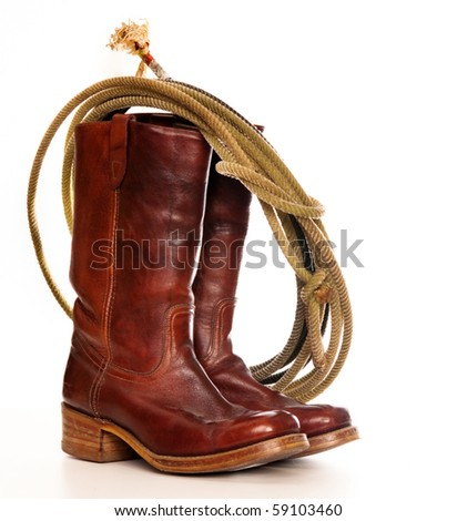 vertical image of a pair of brown cowboy boots and a Lasso on a white background - stock photo