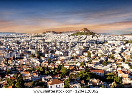 view of Athens with Acropolis hill, Greece. Famous Acropolis is the main landmark of Athens. Scenic panorama of Athens city from above. Landscape of Athens on a sunny summer day. - Image