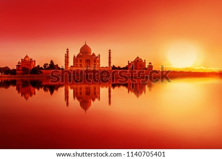 view of Taj Mahal during sunset reflected in the Yamuna river, in Agra , Uttar Pradesh, India #1140705401