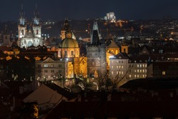 view of the old Prague tower and light from street lighting and view of night Prague in the Czech Republic