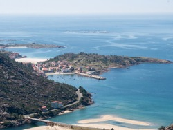 view of the sea and fishing village with beach from the mountains