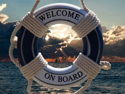 view on the sailing ships in sunset through blue safe belt with welcome on board sign
