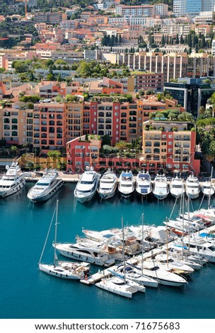 View on top of mooring with yachts and luxury buildings. Monaco