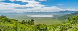 View over Ngorongoro Conservation Area. Ngorongoro Crater is a large volcanic caldera and a wildlife reserve.