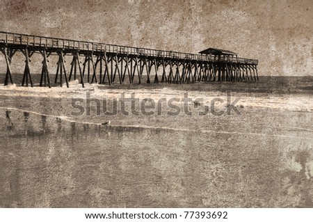 """""""Vintage look"""" of a fishing pier stretching out over the ocean"""