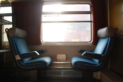 2 Vintage Train Chairs Facing Each Other With Window