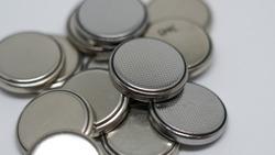 3 volt button batteries on white background
