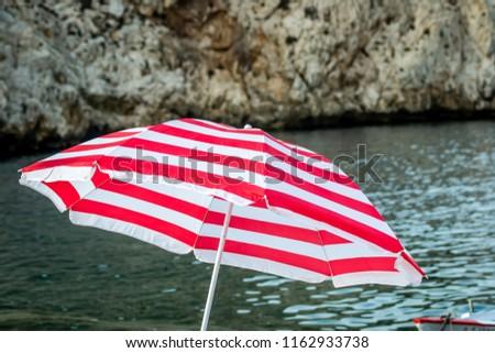 7wade beach with umbrella beach #1162933738