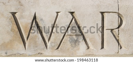 'WAR' carved in stone at Tyne Cot War Cemetery, Flanders, Belgium.  Commemorating World War One  Stock photo ©