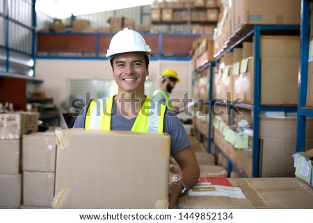 Warehouse worker checking stock products in store Stock photo ©
