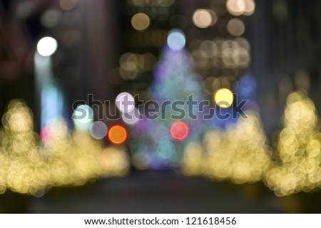 """""""Warm Christmas Lights"""" An abstract blur of Christmas trees in Rockefeller Center in New York City."""