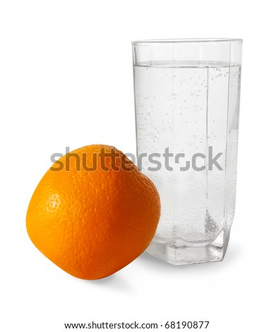 water and fruit. Isolated over white. Focus on glass