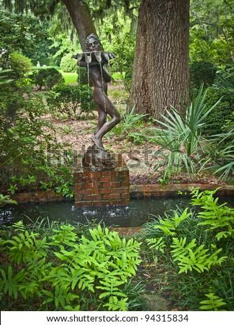 """Water Bearer in Garden"" A statue with fountain in Brookgreen Gardens near Myrtle beach in South Carolina."