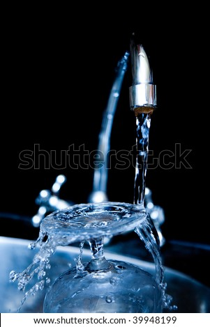 Water dripping from water faucet, closeup