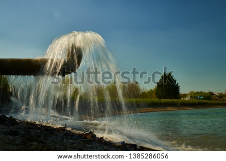 Water flows and forms a curtain                              #1385286056