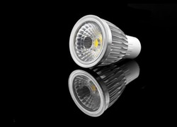 5 watt led lamp on a black reflective surface
