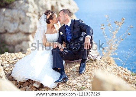 wedding: bride and groom by the sea