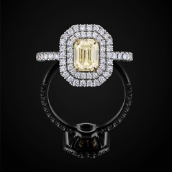 Wedding ring front view with yellow and white diamonds on black background with reflection. Jewellery with gemstone