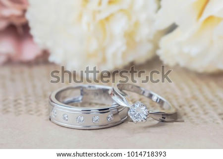 wedding rings, Engagement rings,Wedding rings on background  space for text input. #1014718393