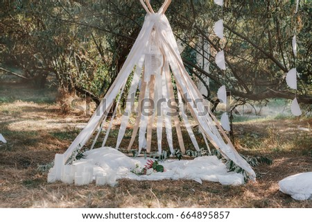 Wedding tent in the style of Boho. Decorated with details, Wedding bouquet and candles #664895857