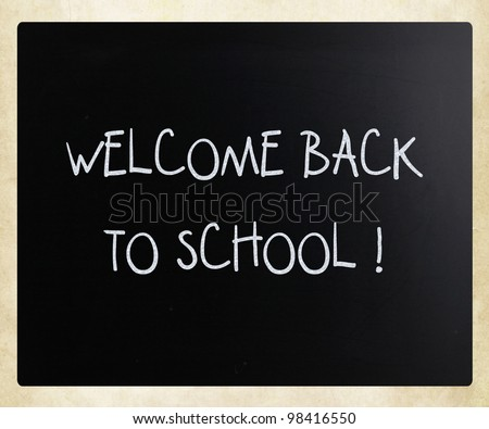 """Welcome back to school"" handwritten with white chalk on a blackboard"