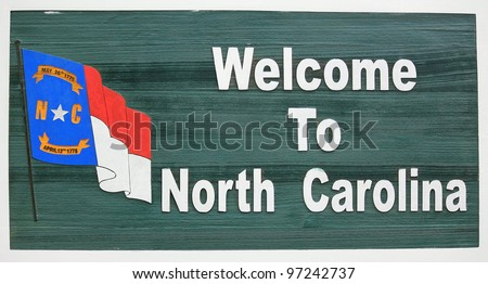 """Welcome to North Carolina"" sign at the Travel and Tourism Welcome Center on the Tennessee and NC border."