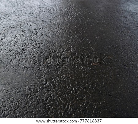 Wet asphalt. Grey asphalt. Wet asphalt background. Wet asphalt texture. Grunge pavement.