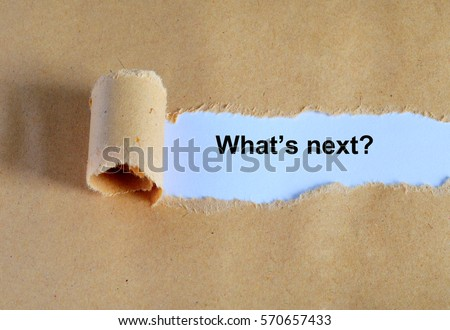 What's next? word written under ripped and torn paper.