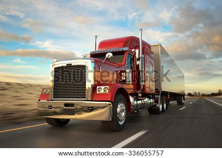 18 Wheel Truck on the road during the day. Side view.