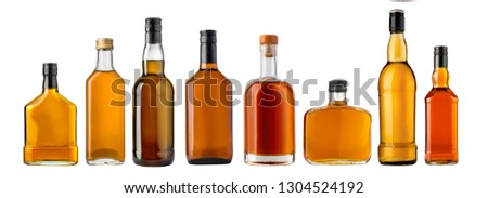 whiskey bottles isolated over a whte background  #1304524192