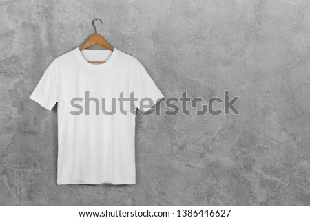 White Blank Cotton Tshirt Hanging Center Gray Concrete Empty Wall Background with clipping path ストックフォト ©