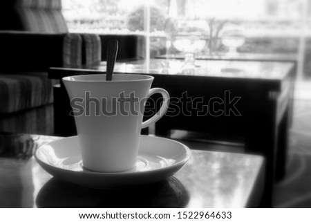 White cup of coffee. A cup of tea. Nice view from the window. Two small cups. China. #1522964633