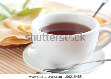 White cup of fragrant tea. Strong black tea