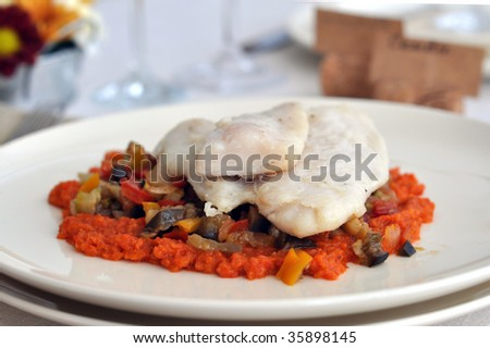 white fish with a sauce of roasted peppers and  ratatouille