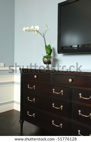 white flowers on the chest of drawers