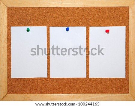3 White Paper pinned on Cork board background