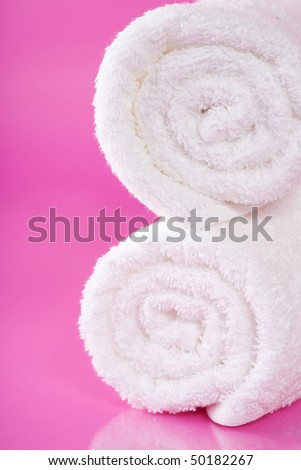 white towels on a pink background - stock photo