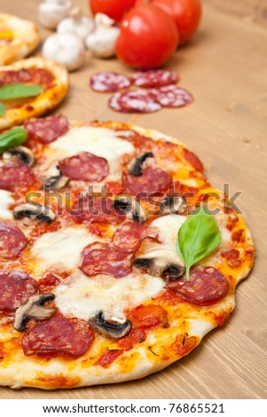 whole salami and mushrooms pizza with ingredients