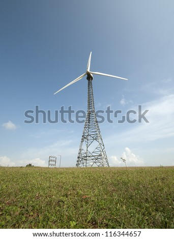 Windmill in green meadow  ,Eco-Energy, conceptual image