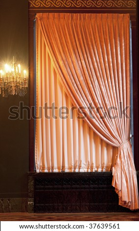 Window curtain with an ornament
