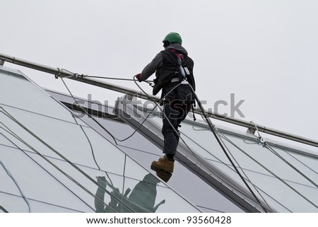 Window washer on a highrise office building - safety work