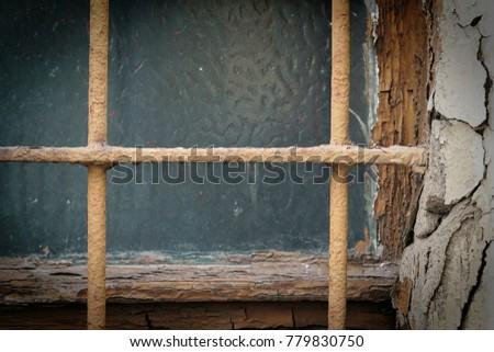 window with window bars on a...