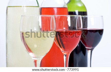 3 wine bottles and glasses in a row including red, white and rose with white background