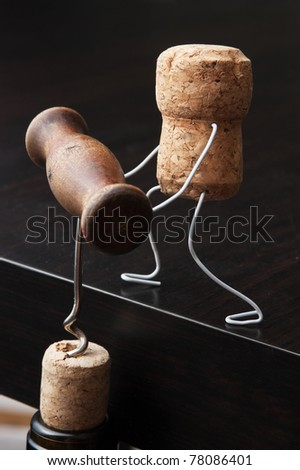wine corks and bottle with the corkscrew