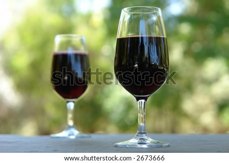 2 Wine Glasses on an outdoor table - stock photo