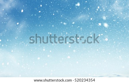 Winter christmas sky with falling snow